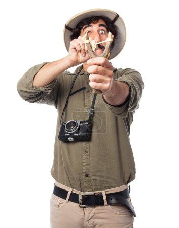 crazy explorer man with slingshot