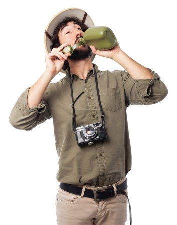 Crazy explorer man with canteen