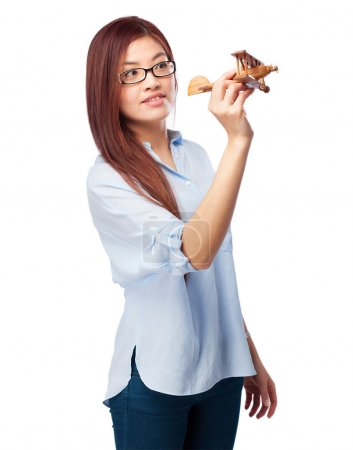 happy chinese woman with plane
