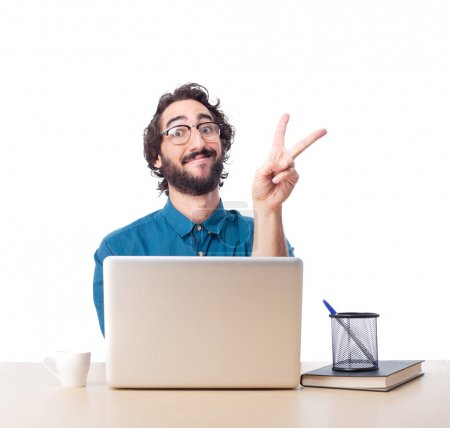 businessman victory sign with laptop