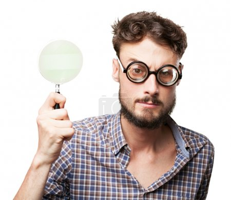 crazy young man with magnifying glass