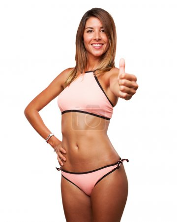 young woman okay sign with bikini