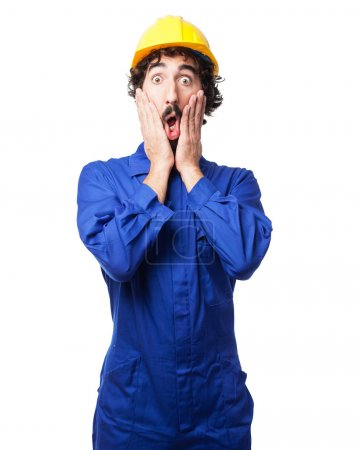 Photo pour Inquiet travailleur homme surpris pose - image libre de droit