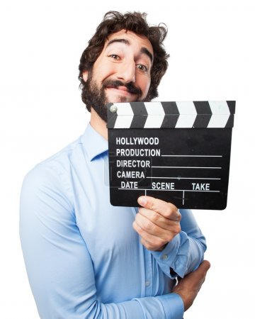 Photo for Happy young man with clapper - Royalty Free Image