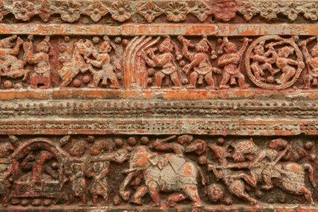 Terracota figures at Pancharatna Govinda Temple in Puthia, Bangladesh.
