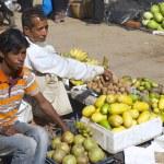 Постер, плакат: Men sell fruits at the local market in Bandarban Bangladesh