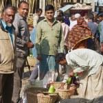 Постер, плакат: Men buy fruits at the local market in Bandarban Bangladesh