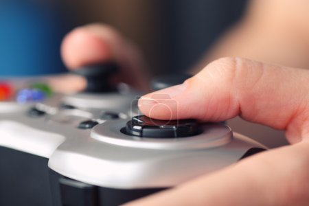 Young woman plays video game using a gamepad
