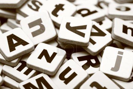 Photo pour Letters Heap. Mélange d'alphabet (Sepia). Plan rapproché. - image libre de droit