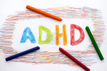 ADHD written on sheet of paper