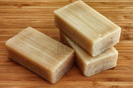 Photo pour Trois barres de savon éco sur fond bois . - image libre de droit