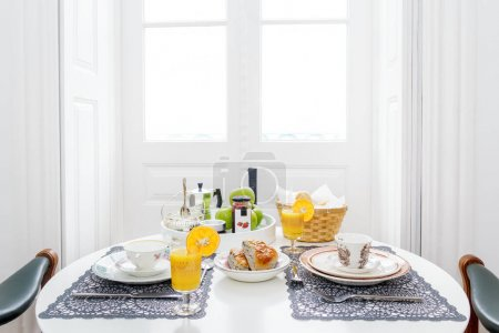 Luxury breakfast table for two with orange juice, ...
