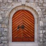 Lock on an old wooden door...