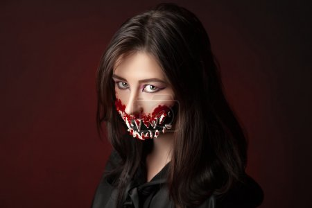 Photo for Character with big teeth and black mouth. Professional make up for horror film (faceart, bodyart, aqua grim), cosmetics. Realistic photo. Can be used for Halloween party, studio horror, milena, milina - Royalty Free Image