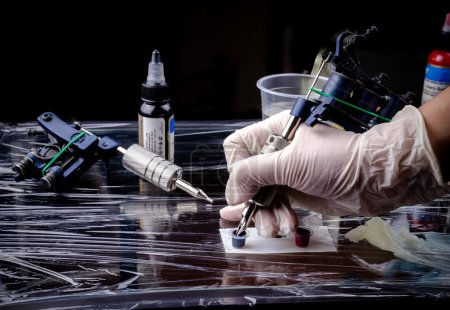 Photo for Process of making tattoo in the studio. - Royalty Free Image