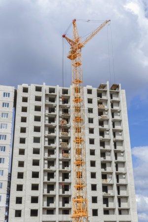 Multi-storey housing and big cranes