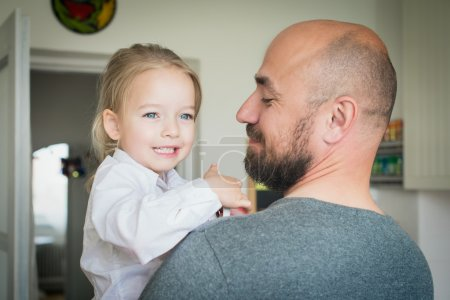 Father and daughter in the kitchen, fathers day concept, real family