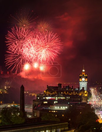 Photo for Edinburgh Cityscape with fireworks over The Castle and Balmoral Clock Tower - Royalty Free Image