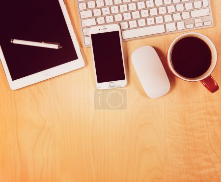 Photo for Office table with digital tablet, smartphone and cup of coffee. View from above with copy space - Royalty Free Image