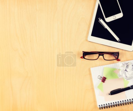 Photo for Office table with digital tablet, smartphone, reading glasses and notepad. View from above with copy space - Royalty Free Image