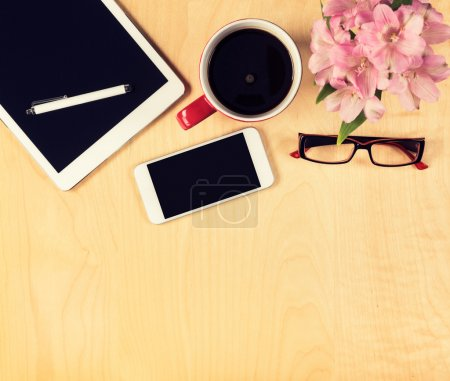 Photo for Office table with digital tablet, smartphone, reading glasses and cup of coffee. View from above with copy space - Royalty Free Image