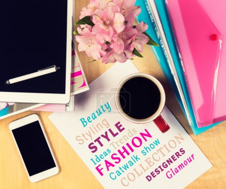 Photo for Office table with fashion magazines, digital tablet, smartphone and cup of coffee. View from above with copy space - Royalty Free Image