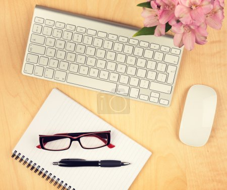 Photo for Office table with notepad, computer and reading glasses. View from above with copy space. - Royalty Free Image