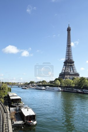 Eiffel Tower vertical landscape, river seine and boats, copy spa