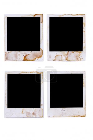 Old vintage stained polaroid style blank photo print frames isolated on white background