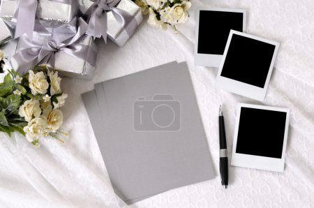 Wedding gifts with writing paper and photos