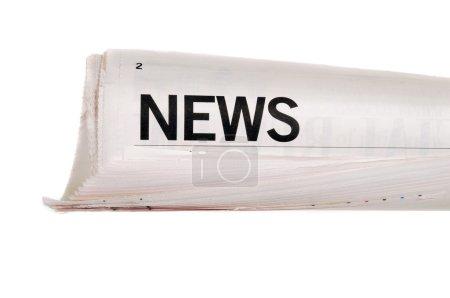 Photo pour Journal enroulé avec des manchettes sur fond blanc - image libre de droit