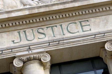 Photo for Justice sign on a Law Courts building - Royalty Free Image