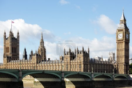 UK Houses of Parliament with blue cloudy sky and U...
