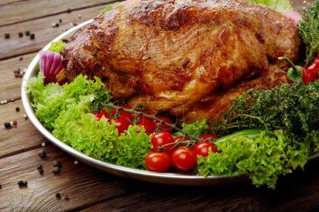 Roasted pork shoulder with vegetables, meat dish