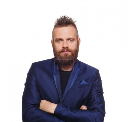 Photo pour Young bearded man isolated at white background. Close up portrait of a confident guy with beard looking at camera. Boy style, trendy hipster look with cool hairstyle in blue suit. Modern businessman. - image libre de droit