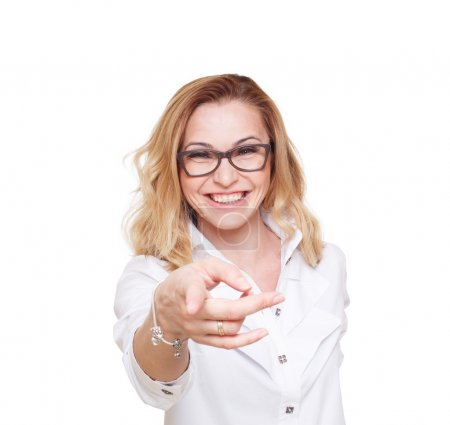Blond woman laugh and point finger isolated on white background.