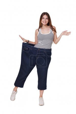 Young woman happy of weight loss diet results, isolated