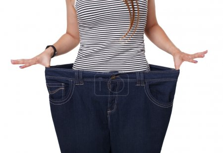 Unrecognizable woman torso, showing diet results isolated on white