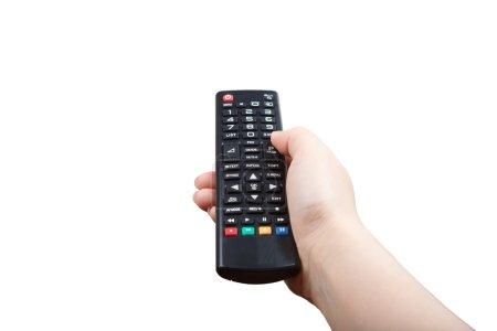 Photo pour Main avec télécommande pointant vers l'avant isolé en blanc - image libre de droit