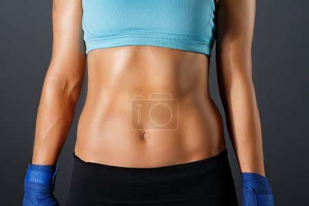 slim sportive woman torso with strong muscles