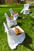 Outdoors wedding ceremony - string quartet's chairs with instrum