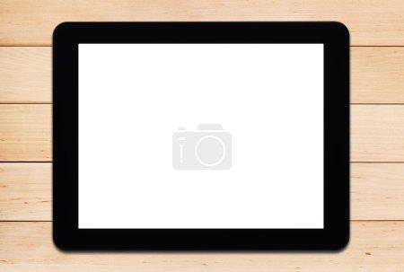 Photo pour Tablette PC noire avec écran blanc sur une table en bois clair - image libre de droit