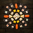 Japanese food restaurant delivery - sushi maki california roll platter set isolated at wooden background, above view