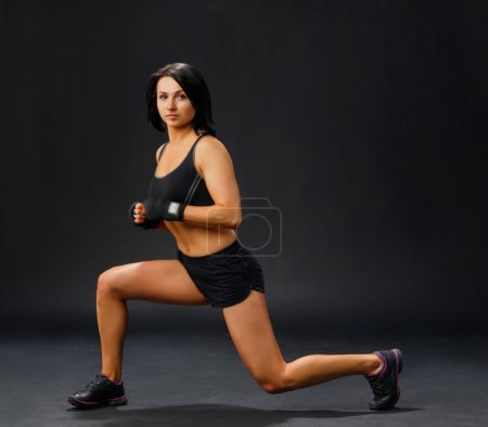 Woman doing fitness forward lunge