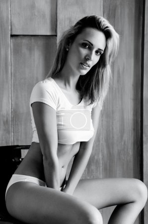 slim girl with blond straight hair