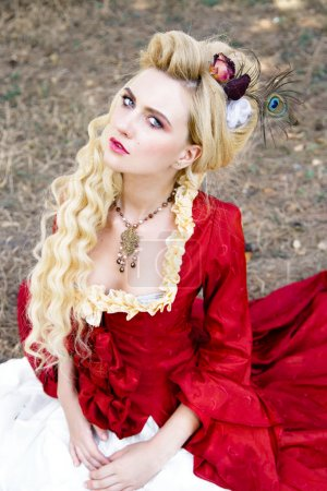 Woman in antique red dress