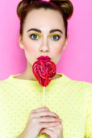 Pretty girl with lollipop