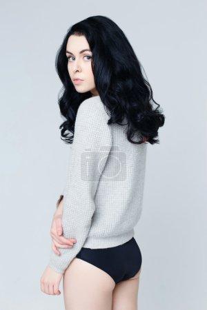 Photo for Portrait of beautiful brunette female model posing in studio - Royalty Free Image
