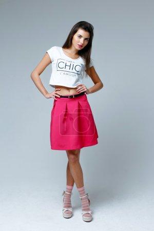 Woman wearing pink skirt