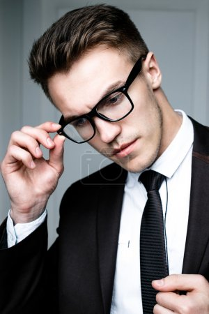 Photo for Portrait of handsome stylish man in elegant black suit wearing eyeglasses - Royalty Free Image